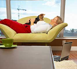 woman in condo with dog on her lap
